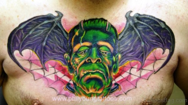 Evil Face Bat Wing Tattoo On Chest