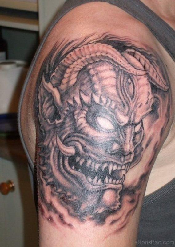 Evil Japanese Mask Tattoo On Right Shoulder