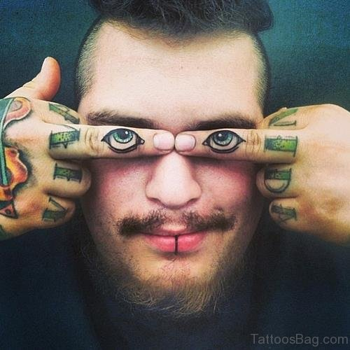 Eyes Tattoo On Finger