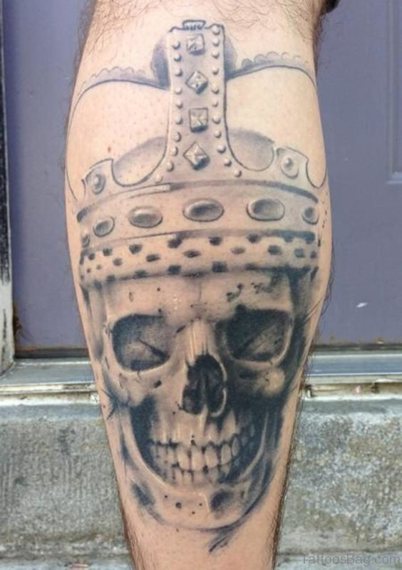 Fabulous Grey Ink King Skull Tattoo On Leg