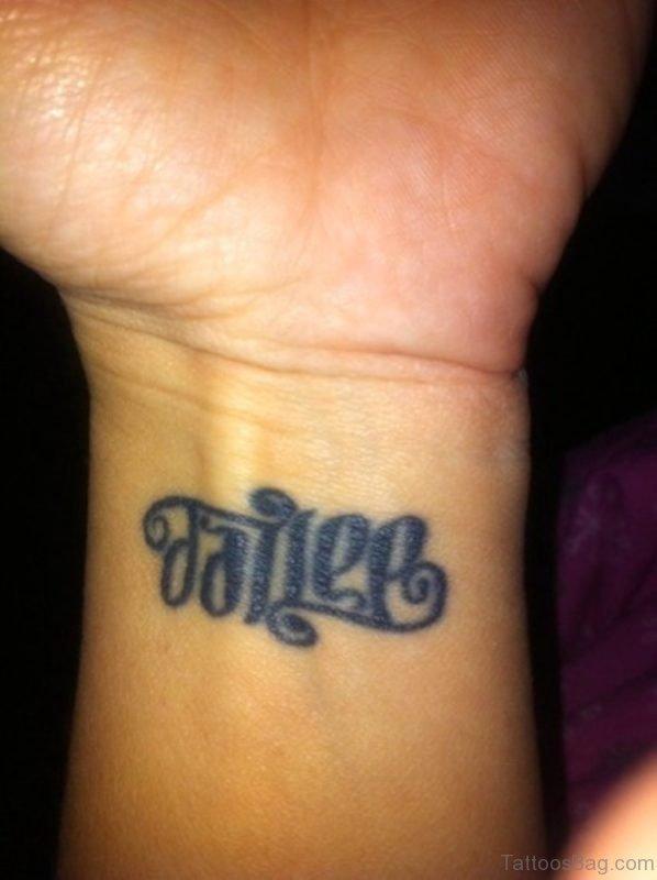 Fallen Ambigram Tattoo On Wrist