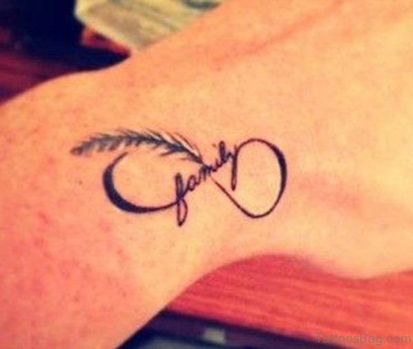 Family Text And Infinity Feather Tattoo On Wrist