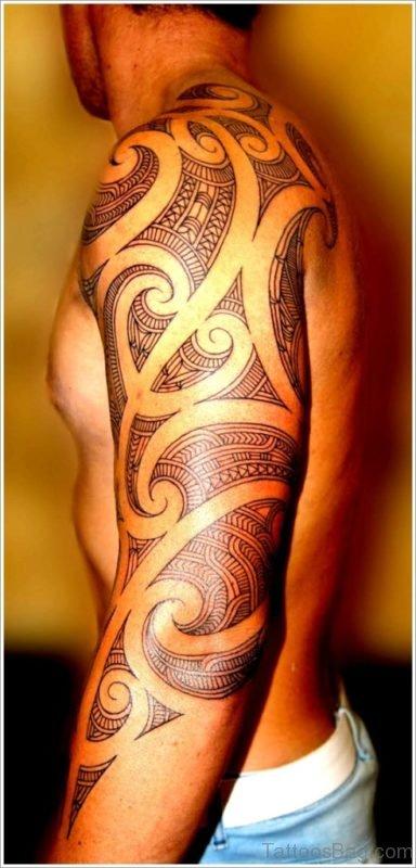 Fancy Maori Tribal Tattoo On Full Sleeve