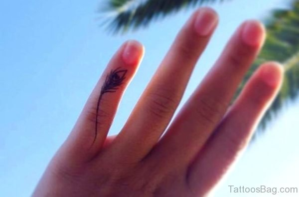 Feather Tattoo On Small Finger