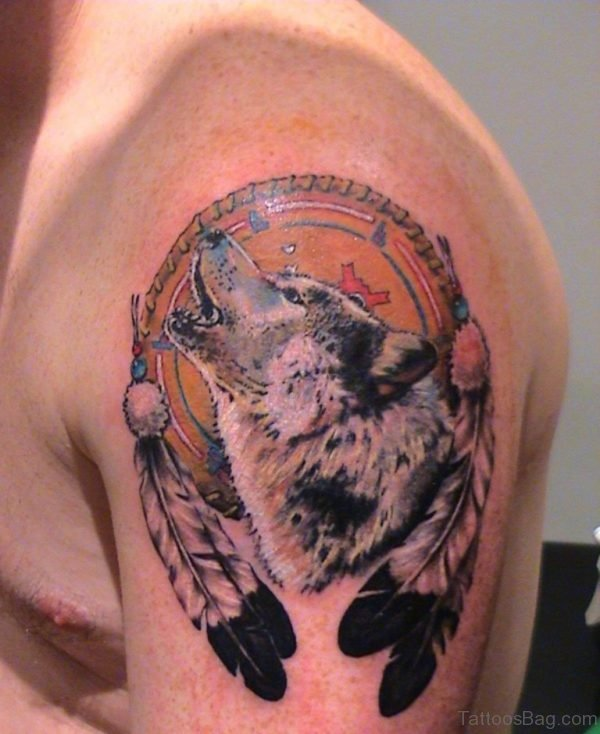 Feathers And Wolf Head Tattoo On Left Shoulder