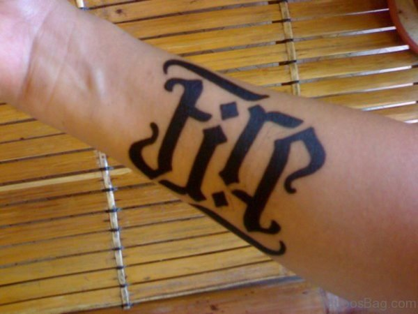 Fire Ambigram Tattoo On Arm