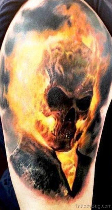Flaming Skull Tattoo On Left Shoulder