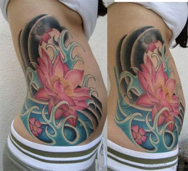 Floral And Lotus Flower Tattoo On Side Rib
