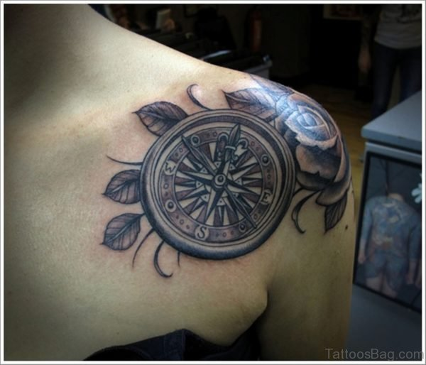 Flower And Compass Tattoo On Upper Chest