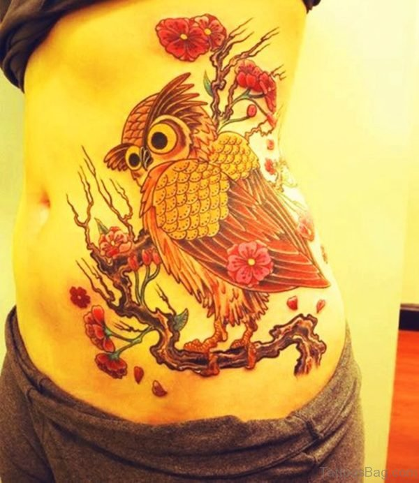 Flower Tree And Owl Sitting Tattoo On Side Rib