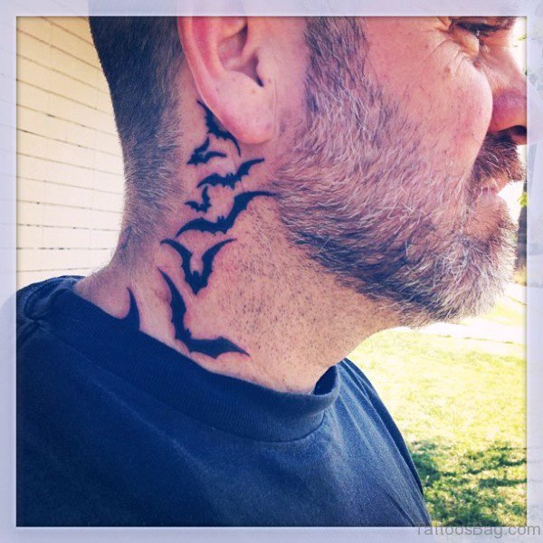 Flying Bats Tattoo On Neck