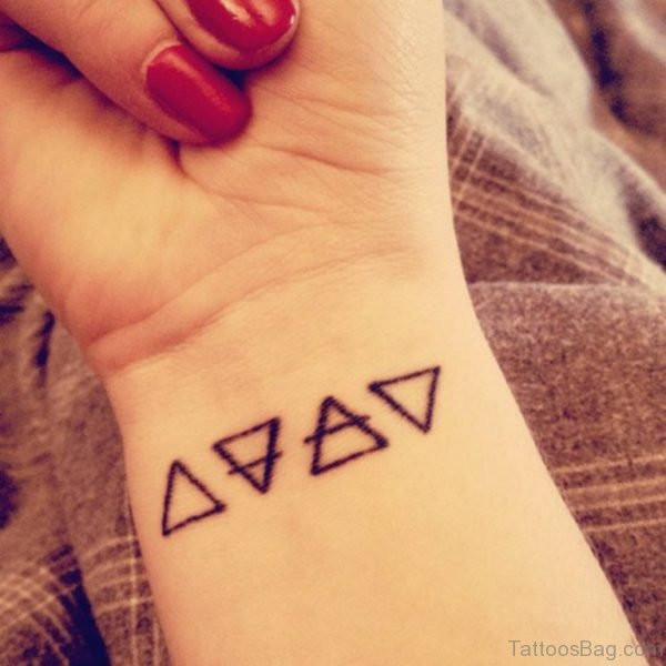 Four Triangle Wrist Tattoo