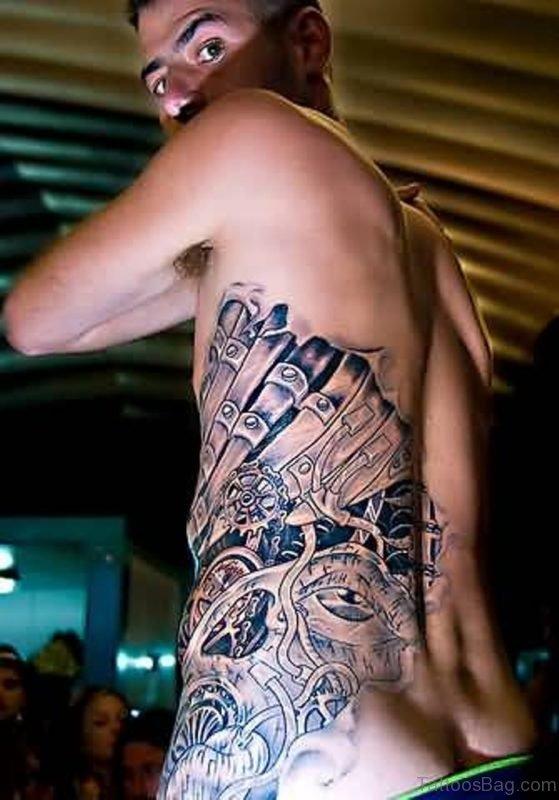 Funky Men Show Biomechanical Tattoo On Rib Side