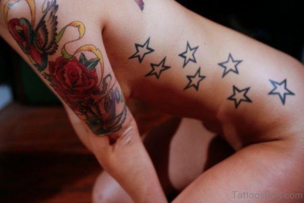 Funky Star Tattoo On Rib