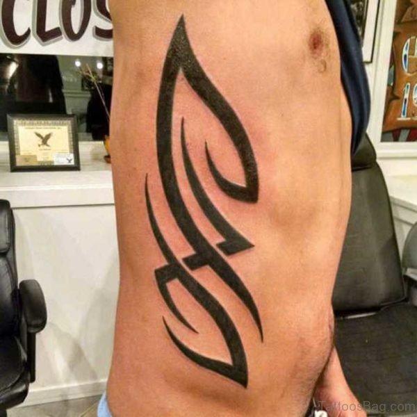Funky Tribal Tattoo On Rib