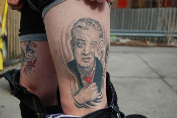 Funny Portrait Tattoo Design On Thigh