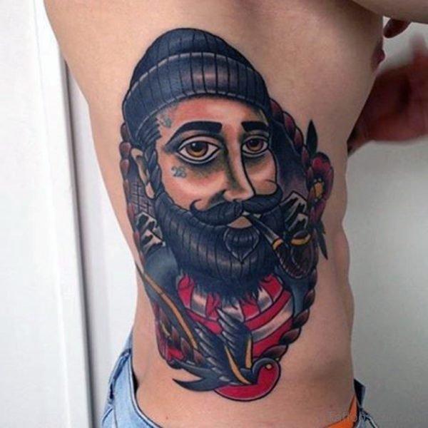 Funny Portrait Tattoo On Rib