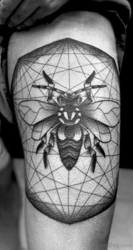 Geometric Bee Tattoo On Man Left Thigh