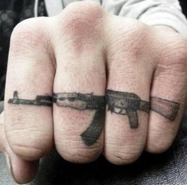 Giraffe Tattoo On Finger