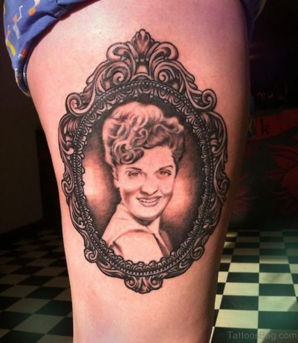 Girl Portrait In Frame Tattoo On Thigh