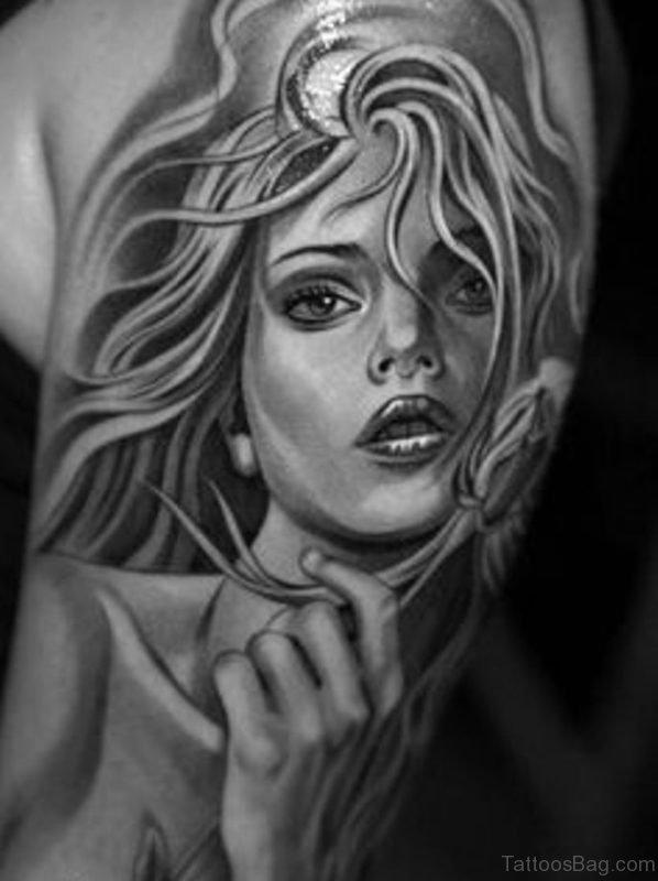 Girl Portrait Tattoo On Bicep