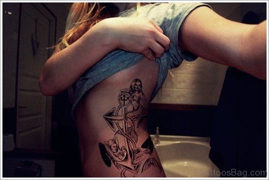 Girl Showing Her Anchor Tattoo On Rib Side