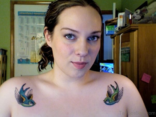 Girl Showing Her Swallow Tattoo