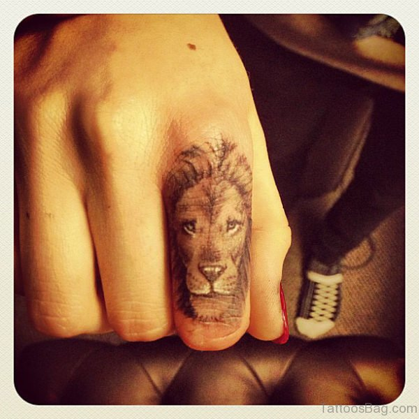 Gorgeous Lion Face Tattoo On Finger