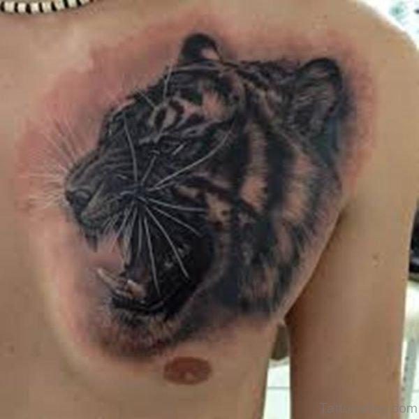 Grey Ink Tiger Head Tattoo On Chest