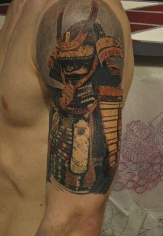Great Mask Tattoo On Shoulder