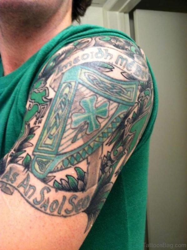 Green Color Celtic Tattoo On Shoulder
