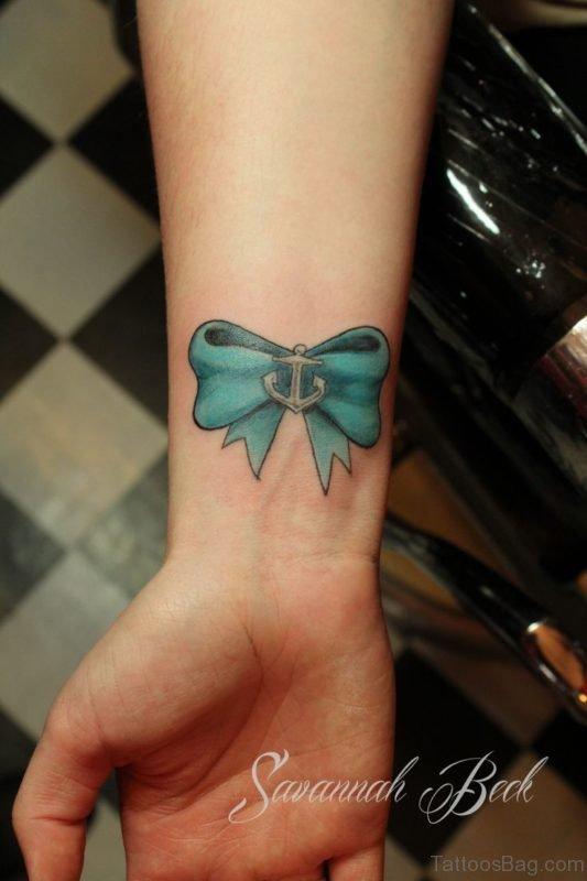 Green Ribbon Tattoo On Wrist