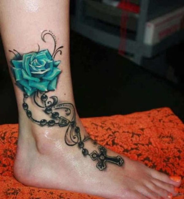 Green Rose With Rosary Cross Tattoo On Ankle