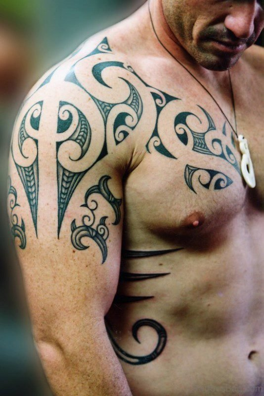 Grey And Black Tribal Shoulder Tattoo