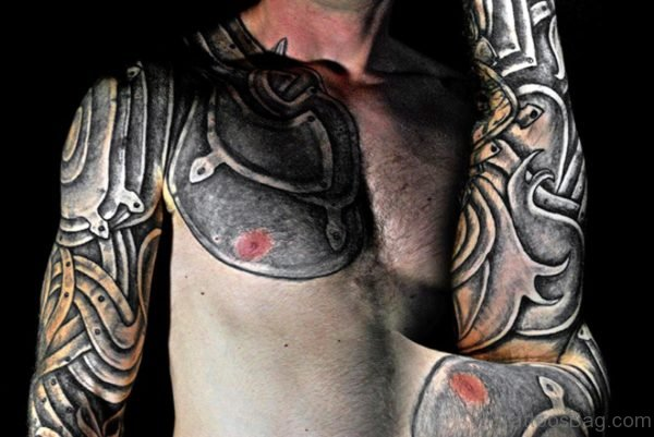 Grey Armour Tattoo On Chest And Arm