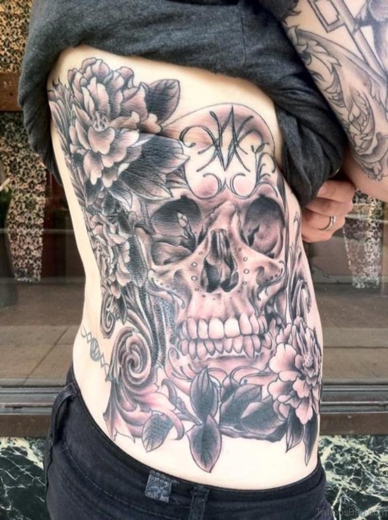59 fabulous skull tattoos for rib for Skull and flowers tattoos