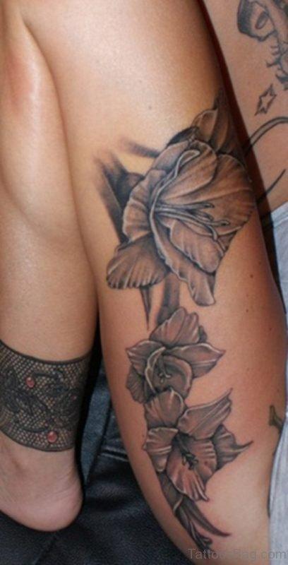 Grey Flower Tattoo On Leg