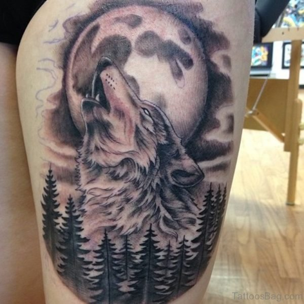 Grey Full Moon And Wolf Head Tattoo On Thigh