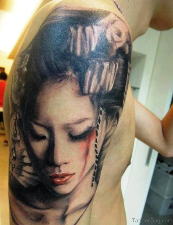 Grey Geisha Face Tattoo On Man Shoulder