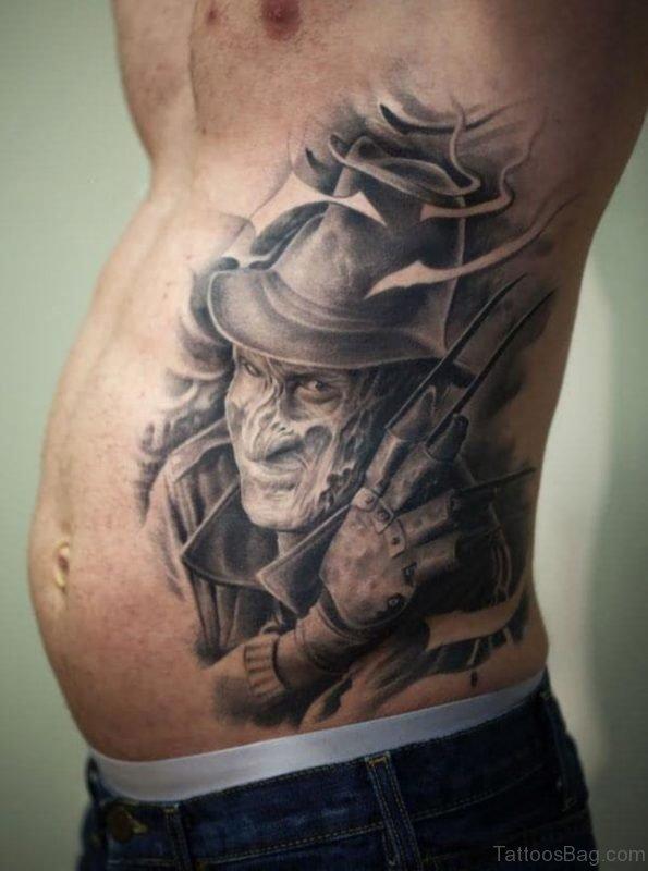 Grey Ink 3D Freddy Krueger Portrait Tattoo On Side Rib