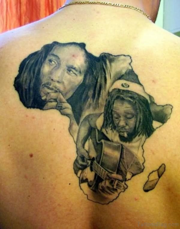 Grey Ink African Singer Tattoo On Back