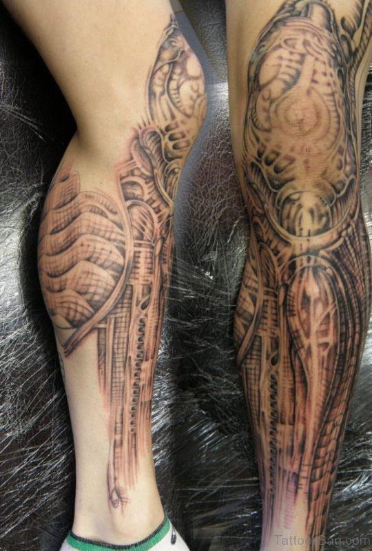 Grey Ink Alien Biomechanical Tattoo On Leg