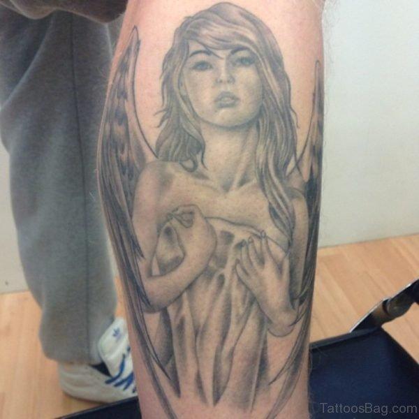 Grey Ink Angel Tattoo On Right Leg