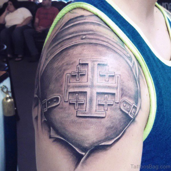Grey Ink Armor Shoulder Tattoo