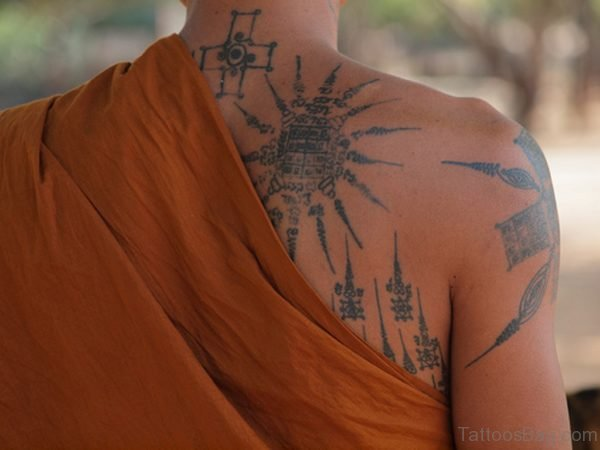 Grey Ink Buddhist Tattoo