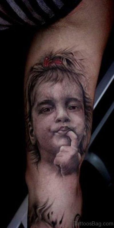 Grey Ink Cute Baby Portrait Tattoo