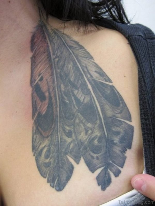 Grey Ink Feather Tattoo