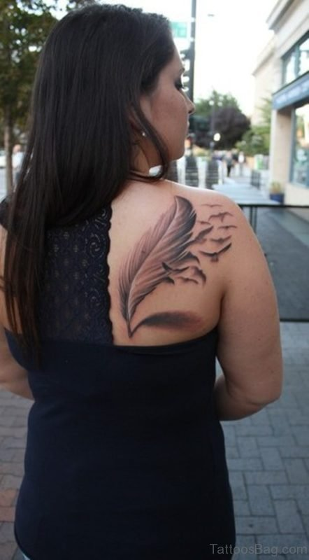 Grey Ink Feather Tattoo On Girl Right BAck