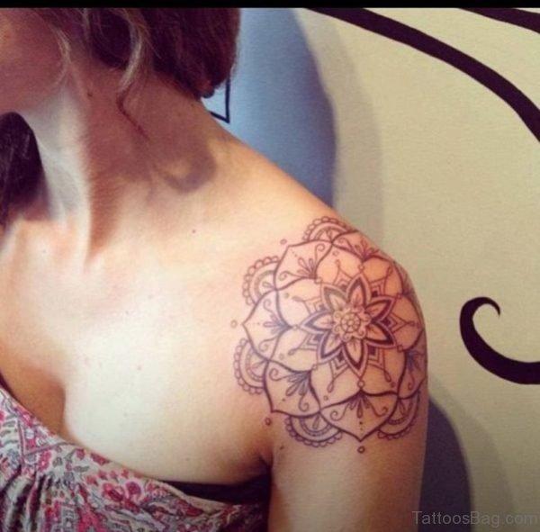 Grey Ink Flower Tattoo On Girl Left Shoulder