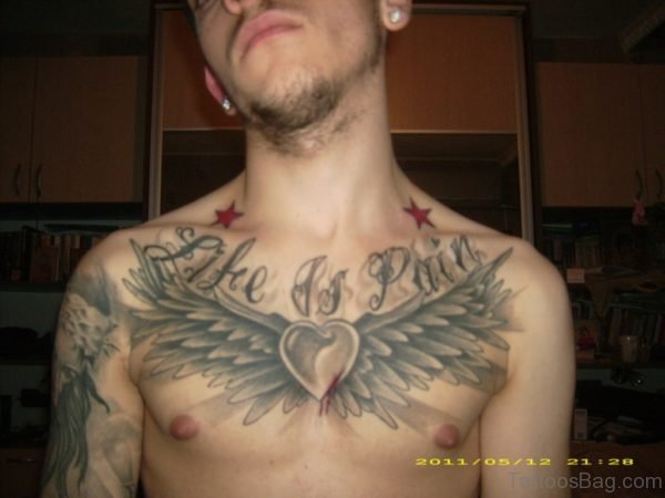Grey Ink Heart And Wings Tattoo On Man Chest